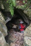 Oparara_Basin_044_12292009 - Julie entering the hole beneath Moria Gate Arch