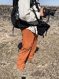 Orange_Hiking_Pants_Demo_002_iPhone_04022021 - Julie examining my Outdoor Research hiking pants