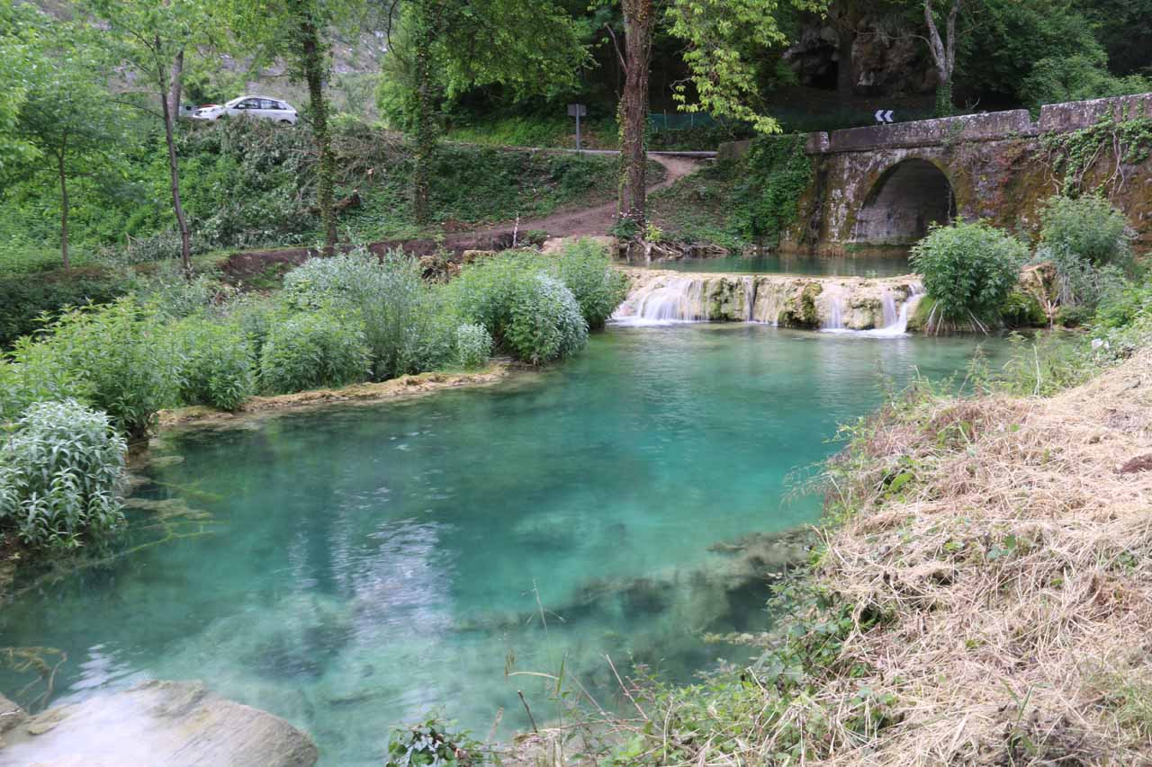 A clear blue pool by the bridge beneath the village of Orbaneja del Castillo