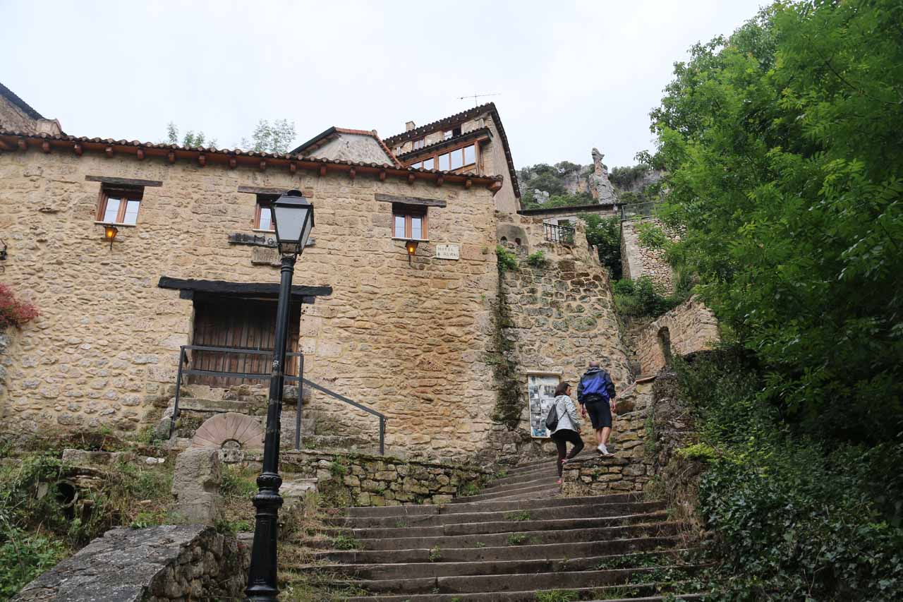 Going up the steps next to the waterfall to get up to the town of Orbaneja del Castillo