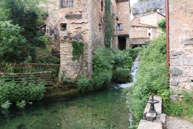 Orbaneja_del_Castillo_080_06132015 - Looking upstream towards an upper cascade tumbling right from the center of the village of Orbaneja del Castillo