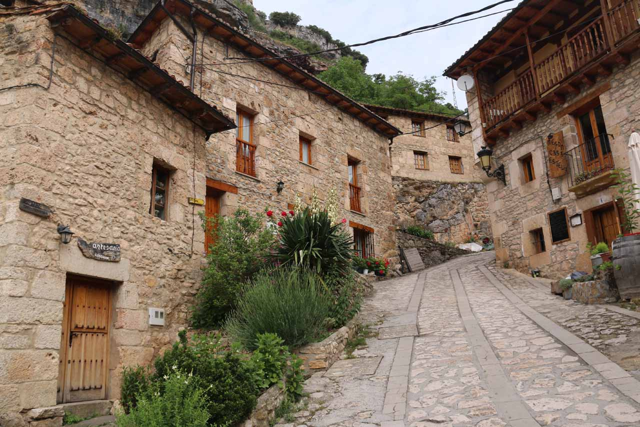 Walking up the steep street as we pursued an overview of the town of Orbaneja del Castillo as well as the rock walls backing the town