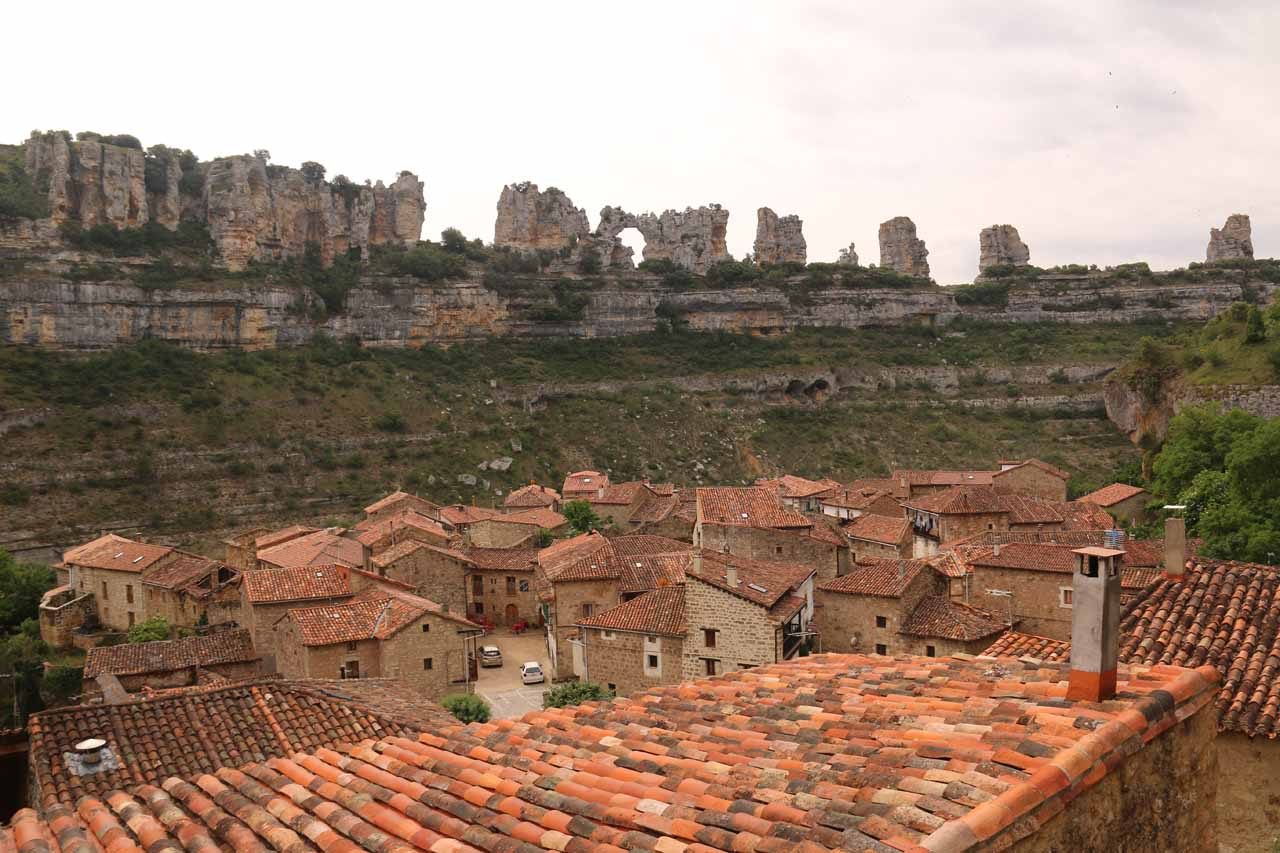 Looking over Spanish-tiled rooftops towards the cliff formations across from Orbaneja del Castillo