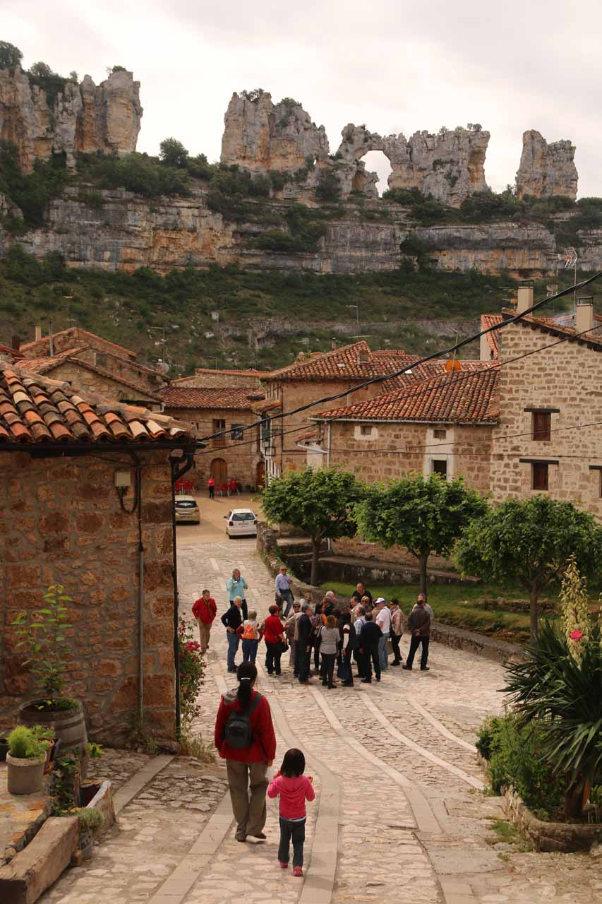 Julie and Tahia returning to the center of Orbaneja del Castillo where there was now a big tour group