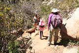Ortega_Falls_014_03172019 - Tahia and Julie squeezing past some people on the return over some eroded parts of the trail