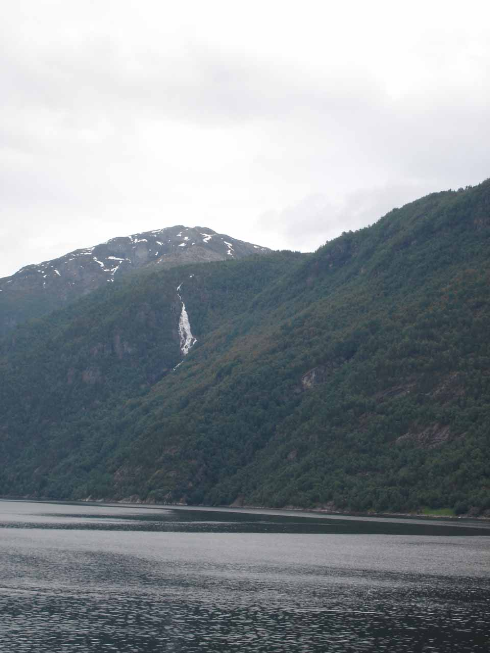 Distant view of some waterfall across the fjord on our way to Osa from Ulvik