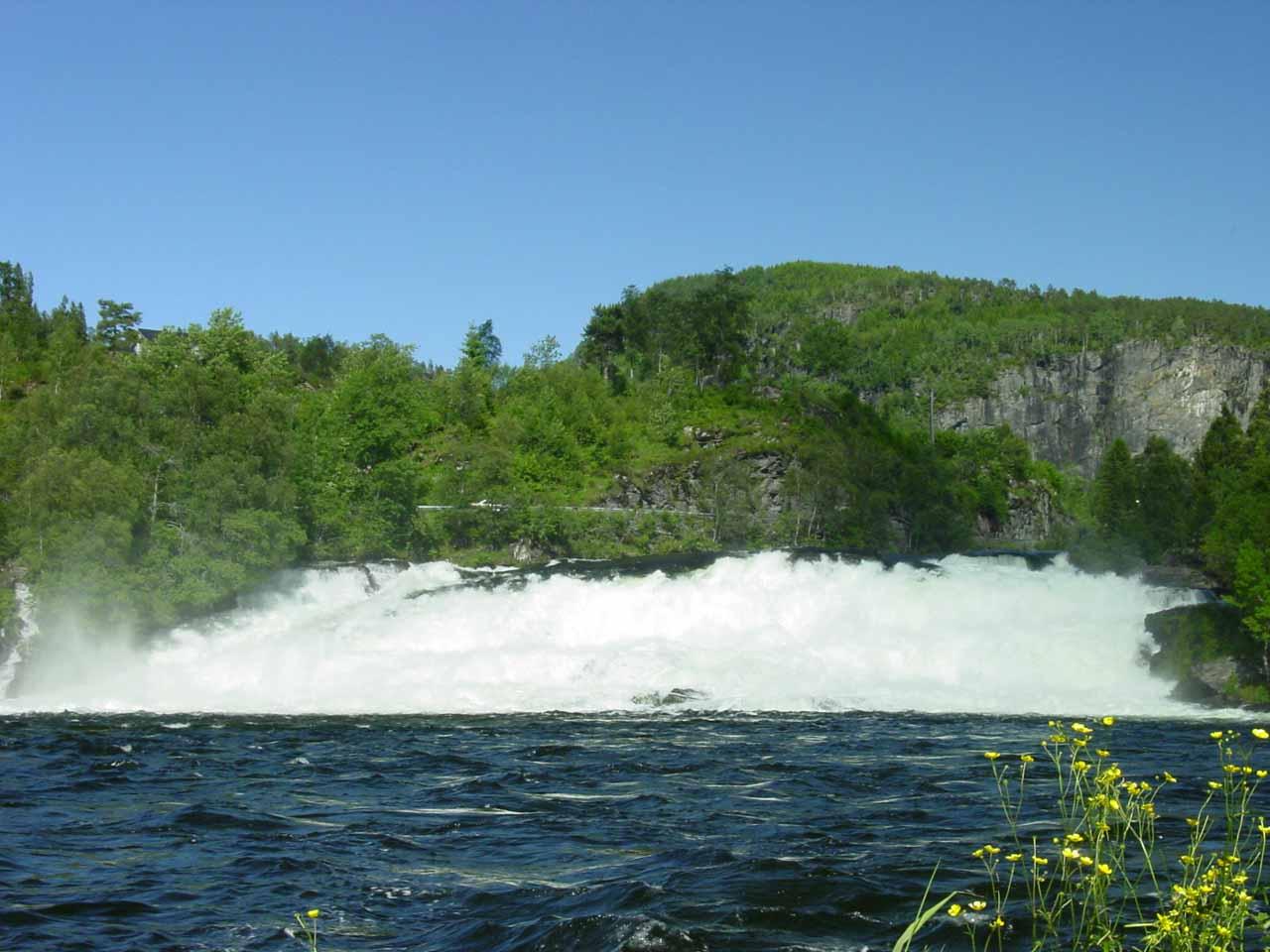 The broad Osenfossen or Osfossen waterfall near the head of Dalsfjorden seen on the way to Laukelandsfossen