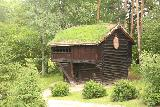 Oslo_518_06182019 - A two-story building with a turf-roof at the Norsk Folkemuseum in Oslo