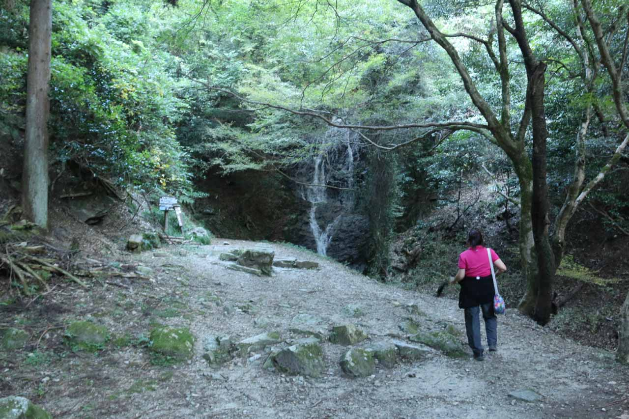 Mom approaching the intimate Otonashi Waterfall