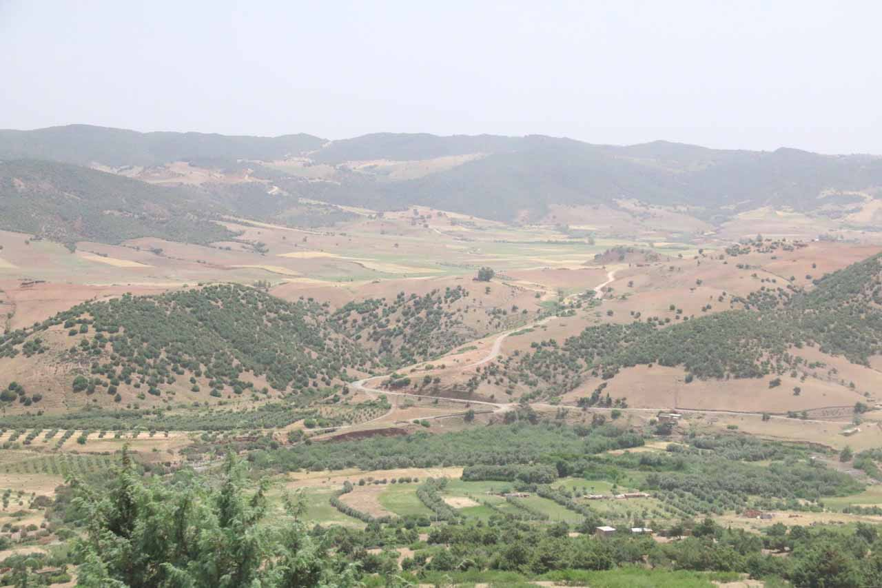 Looking towards a fertile valley in Oum-er-Rbia surrounded by brown hills