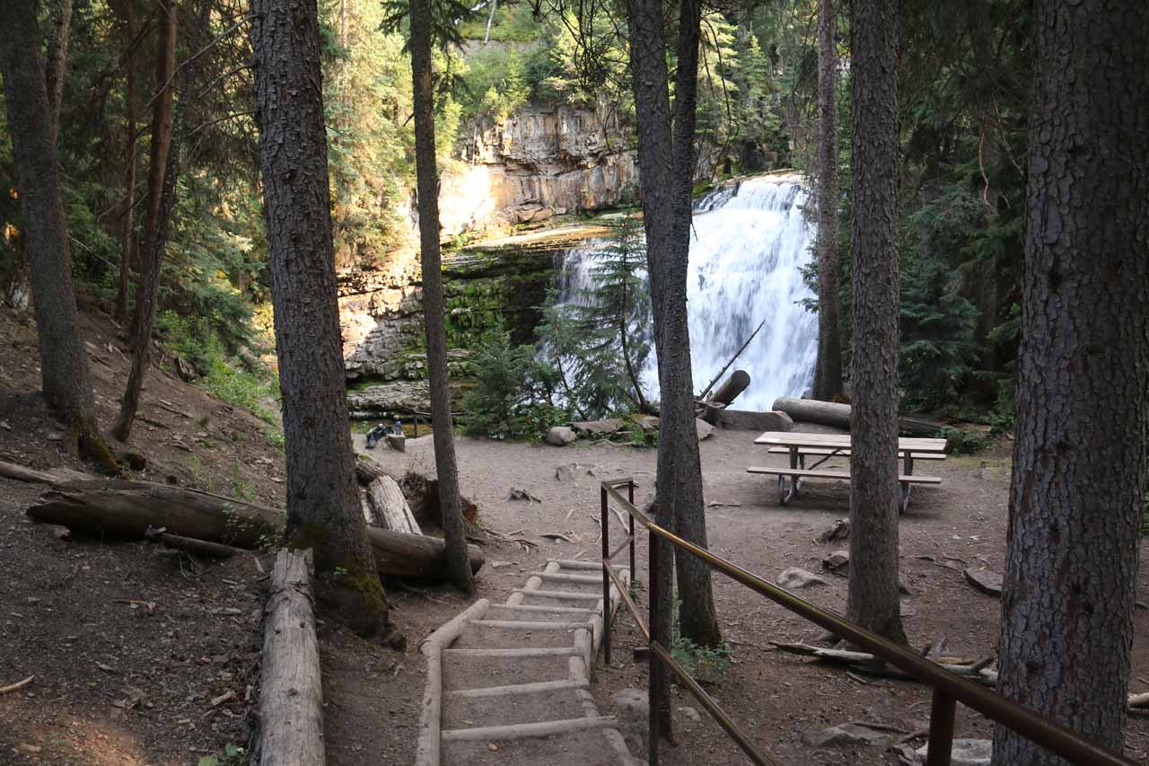Descending some steps towards a set of picnic tables as well as the base of Ousel Falls