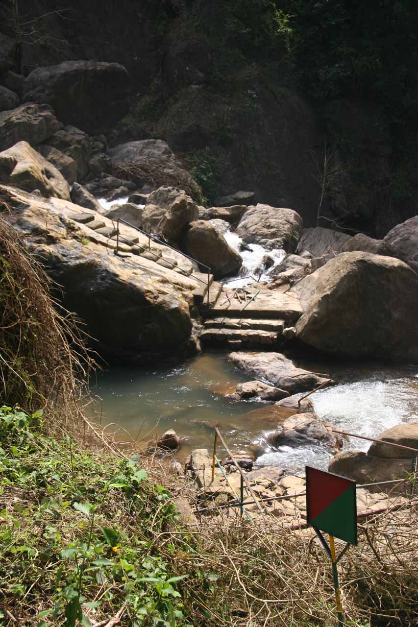 Looking across at the washed out bridge leading to the closed off men's only section of the Palaruvi Falls