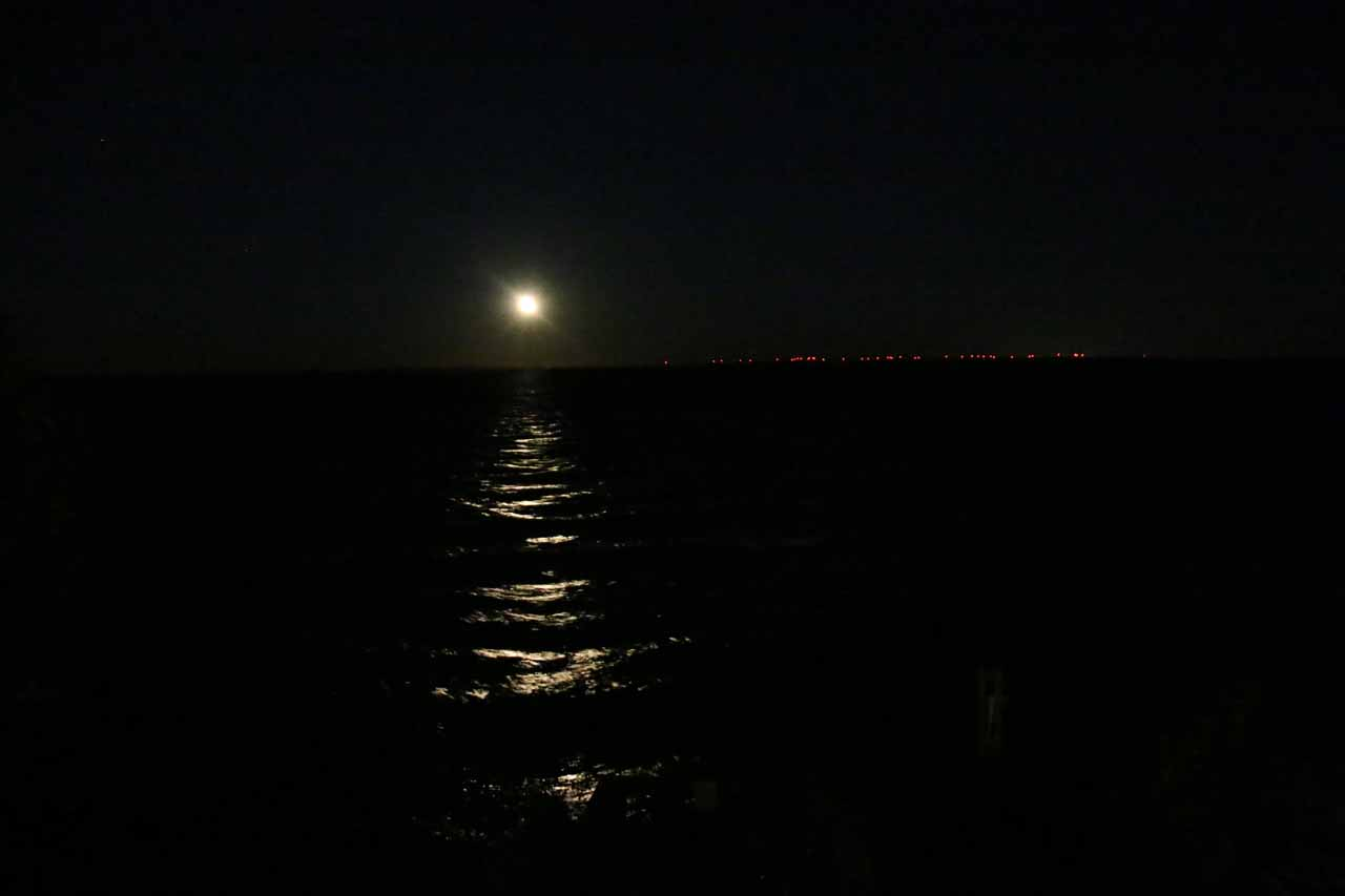 Full moon over Lake Superior as seen from our room in Paradise, Michigan. The red dots turned out to be from windmills