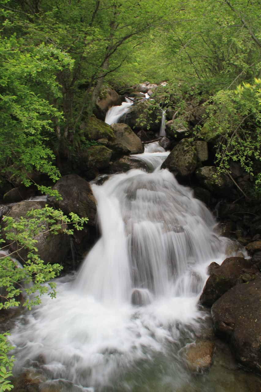 A minor cascade spilling right before the road bridge
