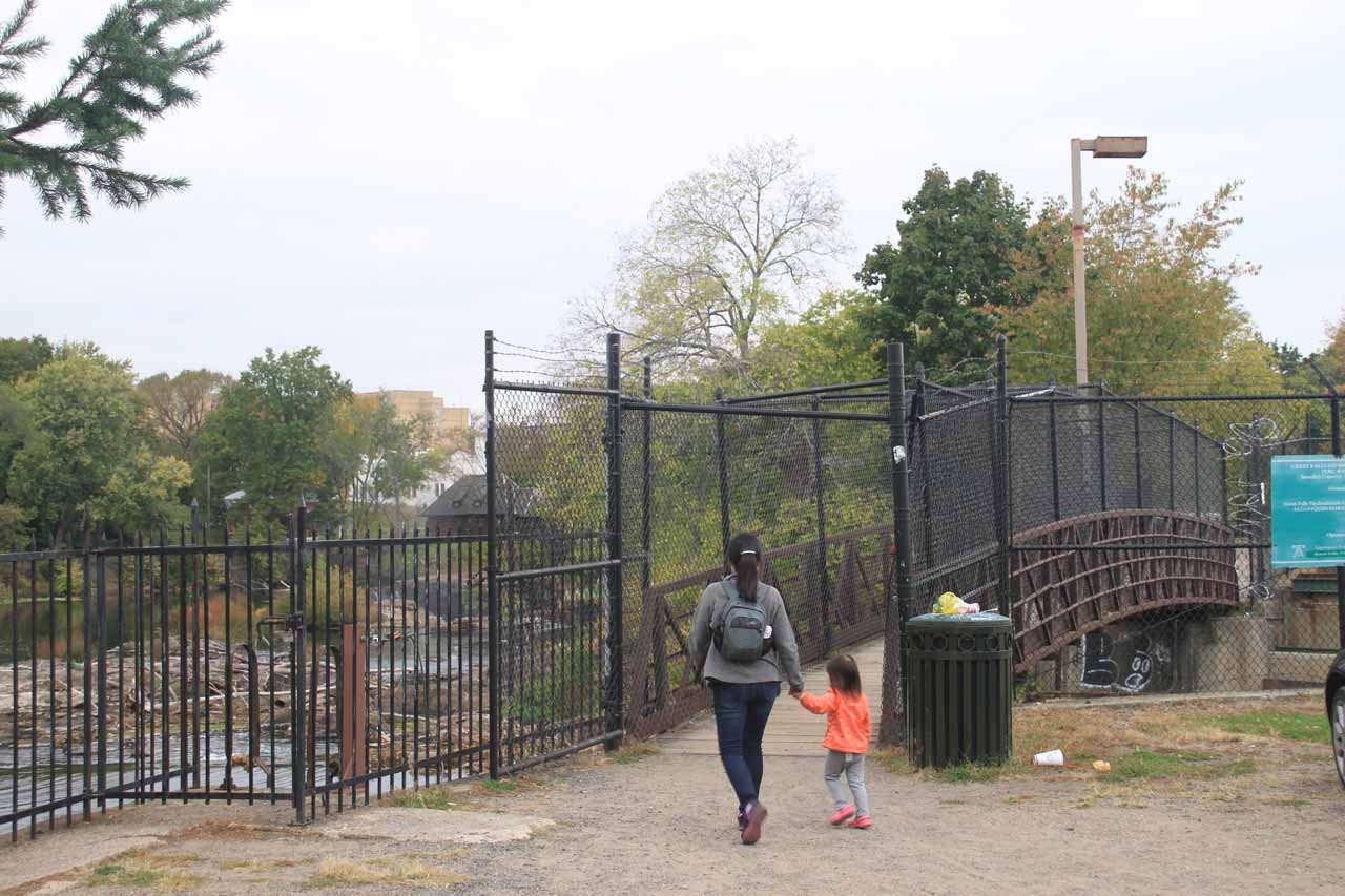Going past a gate and onto the bridge leading closer to Passaic Falls