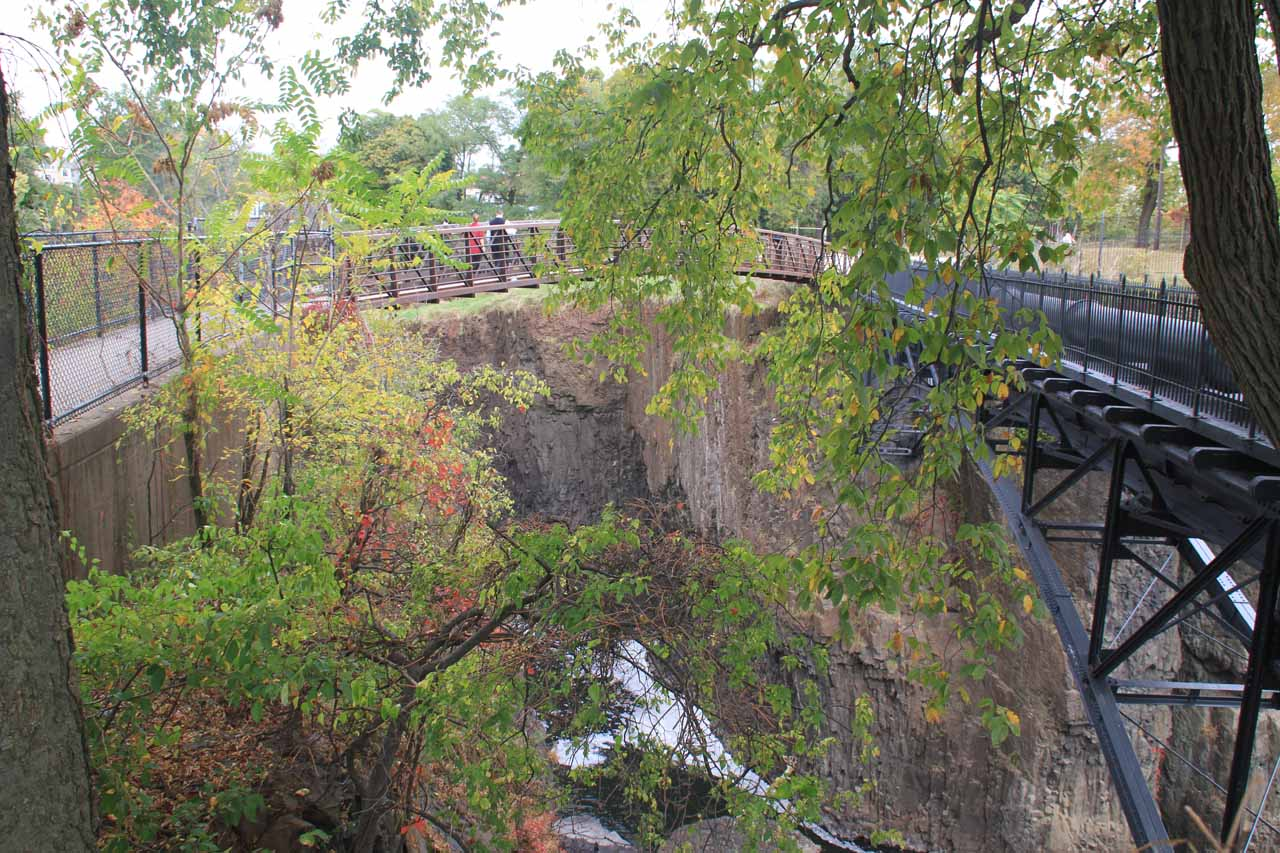 Looking towards the gorge between the footbridge on the left and the pipes on the right
