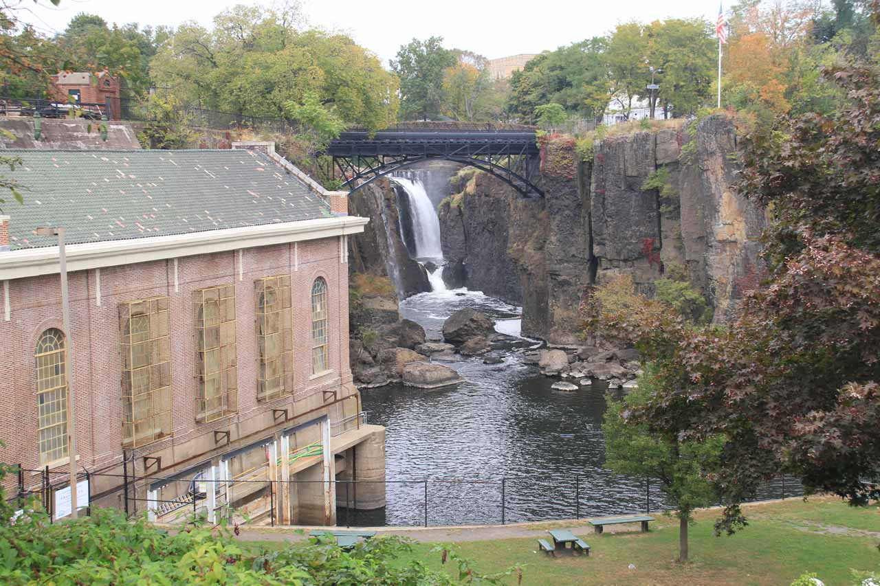 Looking towards the Passaic Falls with the pipe and bridges crossing the gorge along with the SUM building to the left from McBride Avenue