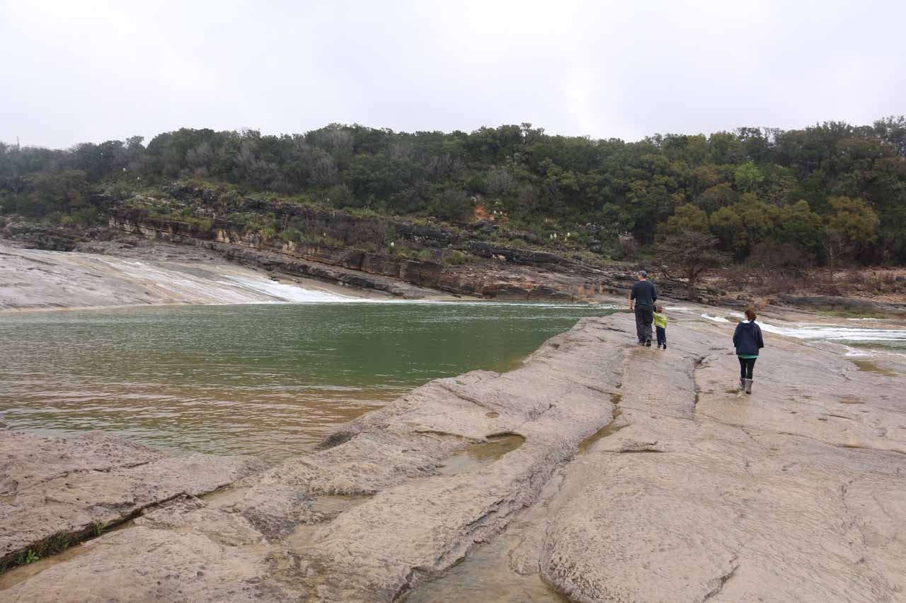Another family decided to walk onto the slippery rocks and get closer to the brink of one of the tiers of Pedernales Falls