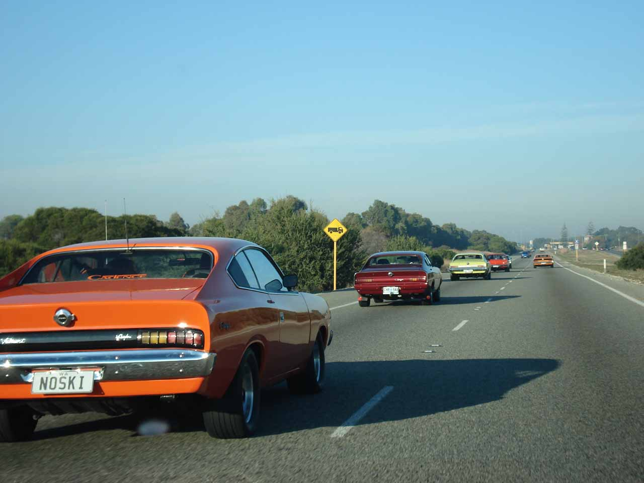 Passing by the group of Dukes of Hazard cars