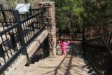 Petit_Jean_SP_028_03162016 - Tahia taking the steps below the overlook in pursuit of an alternate view from the tops of the cliffs overlooking Cedar Falls