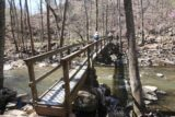 Petit_Jean_SP_133_03162016 - Julie and Tahia going across the narrow bridge over Cedar Creek, where only two people at a time were allowed on