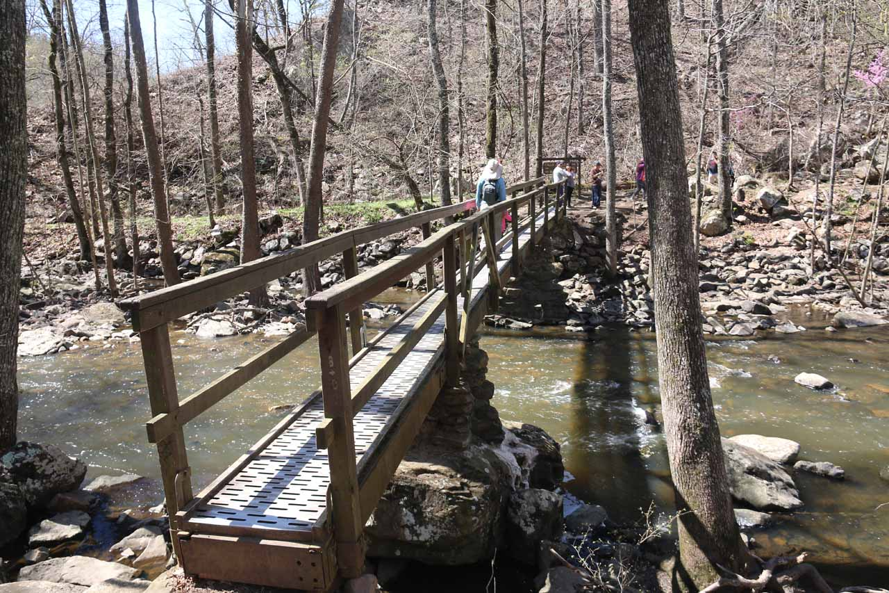 Julie and Tahia going across the narrow bridge over Cedar Creek, where only two people at a time were allowed on