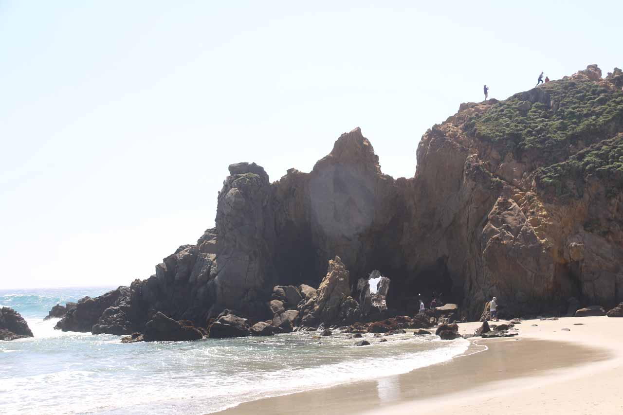 Looking towards a pair of small sea arches at Pfeiffer Beach