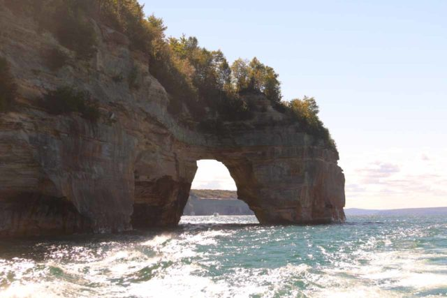 Pictured_Rocks_cruise_235_09302015 - The Lover's Leap arch looking against the early afternoon sun as the boat went past it; this was one of a handful of 'sea' arches seen during the Pictured Rocks Cruise