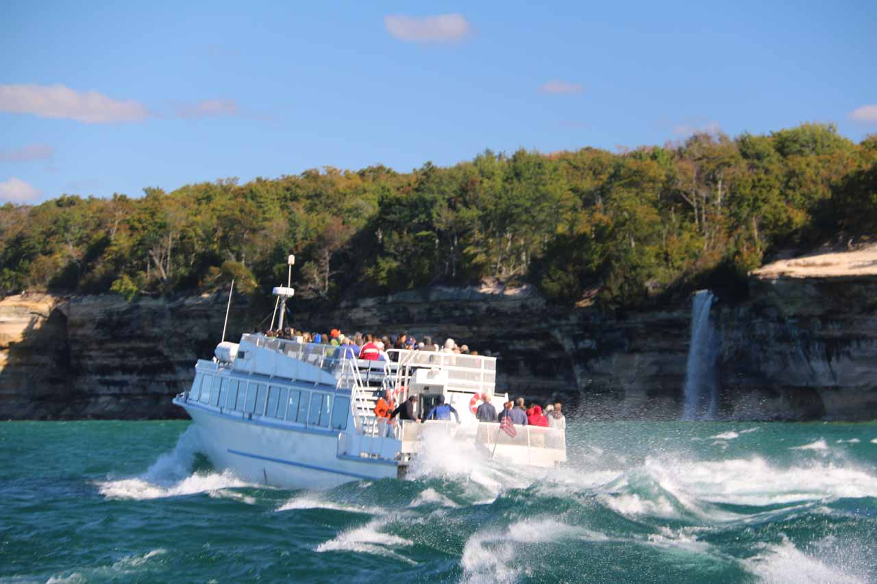 Context of another Pictured Rock cruise boat turning around before Spray Falls