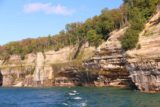 Pictured_Rocks_cruise_451_09302015 - Looking back at attractive pattern cliffs of the Pictured Rocks under attractive light