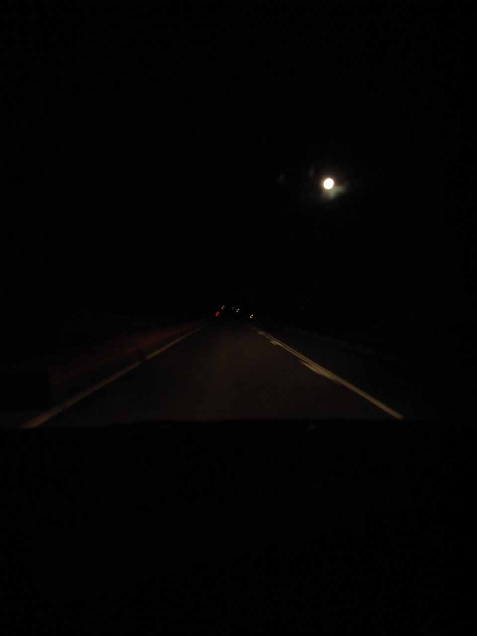 Driving under the light of the full moon towards the Pilbara