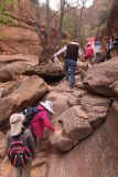 Pine_Creek_Falls_057_04042018 - The family climbing over another little bouldering obstacle en route to the Pine Creek Falls during our April 2018 visit