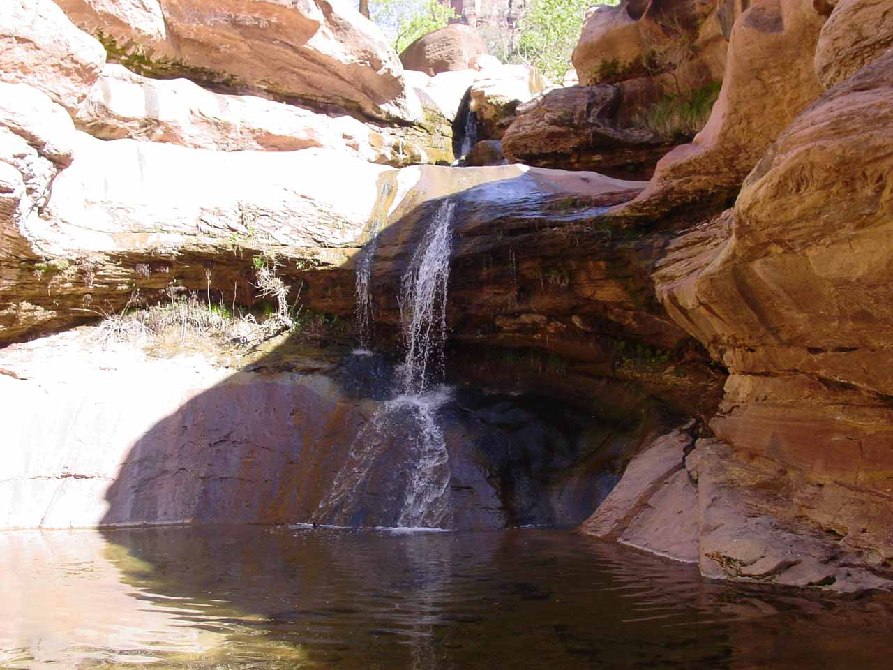 Here's a broad look at the Pine Creek Waterfall and its chilly pool at its base