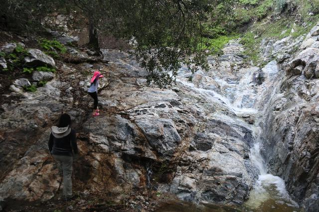 Placerita_Canyon_048_01192019 - Tahia and Julie climbing to the left side of an intermediate waterfall obstacle as the hike to Placerita Creek Falls started to get rougher