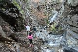 Placerita_Canyon_077_01192019 - A closure sign discouraging any further progress (or at least discouraging people from climbing the cliffs to get up beyond this waterfall)