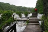 Plitvice_110_05312010 - Context of Julie continuing to walk on the boardwalk of the Lower Lakes as it went right up through the upper part of the Sastavci Waterfall