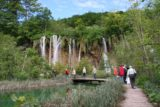 Plitvice_313_06012010 - Context of a tour group on the boardwalk walking by one of the more impressive waterfalls in the Upper Lakes section