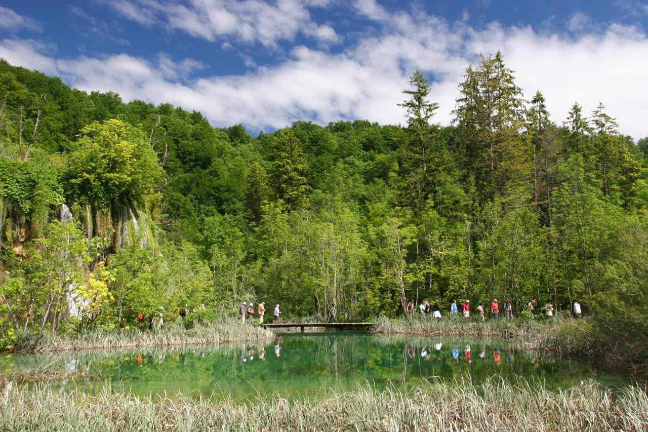 In between the waterfalls are colorful ponds and lakes just like this one