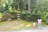 Portland_Japanese_Garden_17_020_08182017 - Julie and Tahia walking by some kind of small pagoda monument in the Portland Japanese Garden