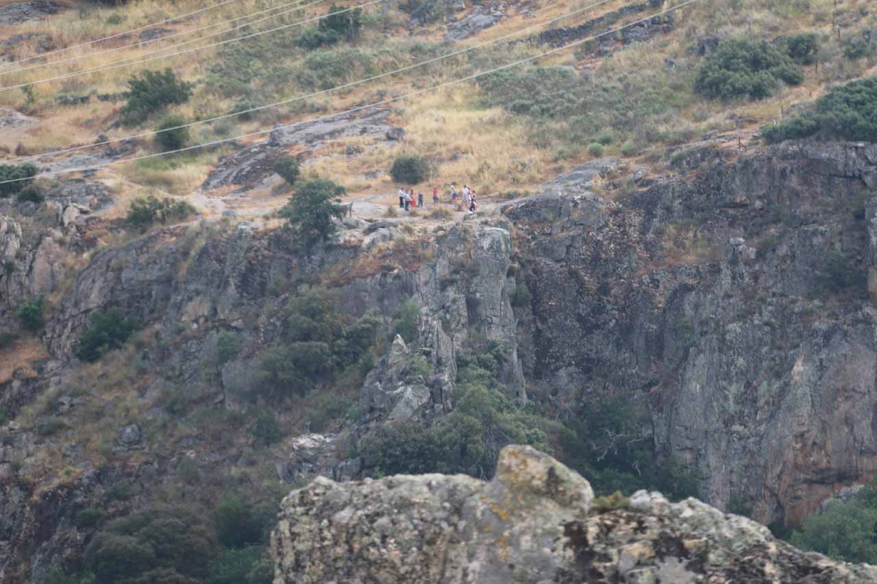 Looking across the gorge towards a group of hikers checking out Pozo de los Humos from the Pereña de la Ribera side