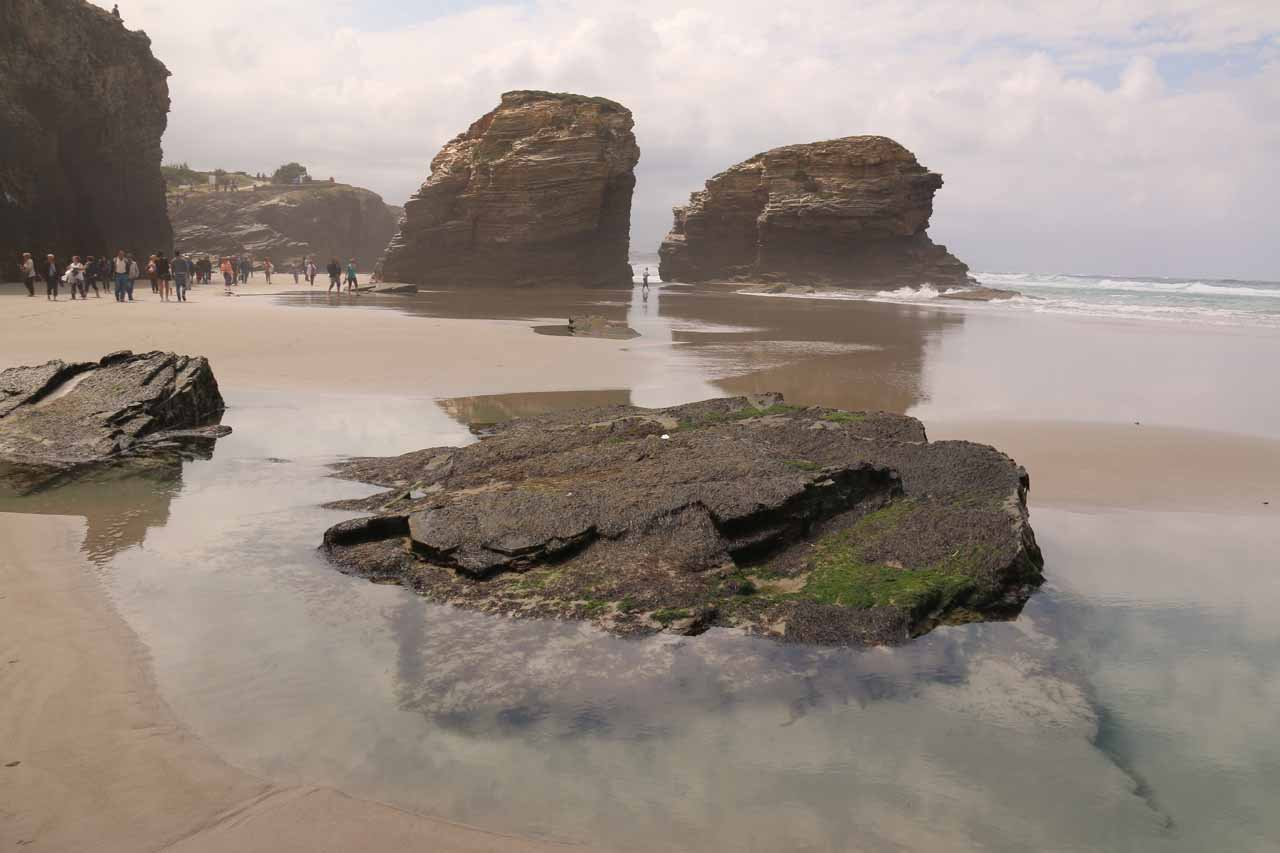 Checking out some interesting rocks scattered about Praia As Catedrais