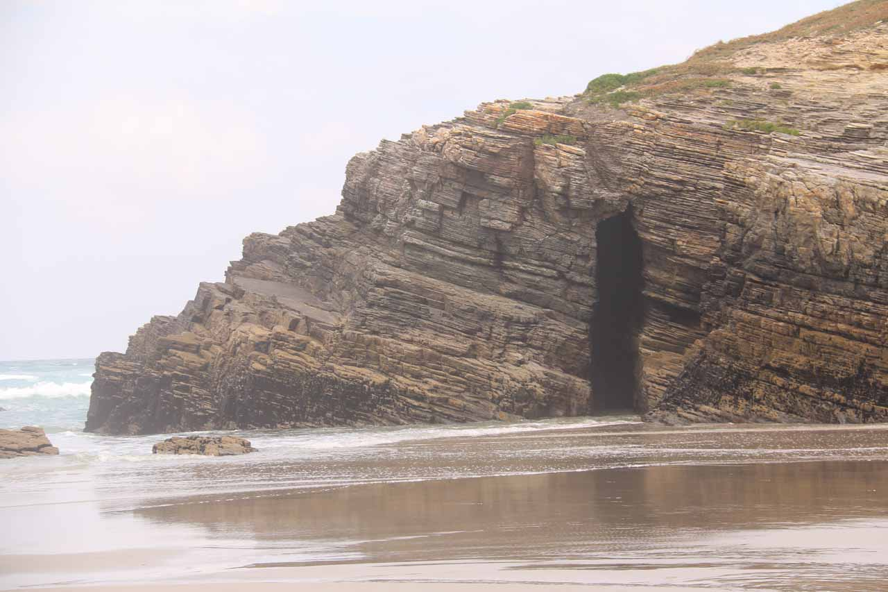 Looking towards a cave that is partially inundated with water as we were still awaiting lowest tide
