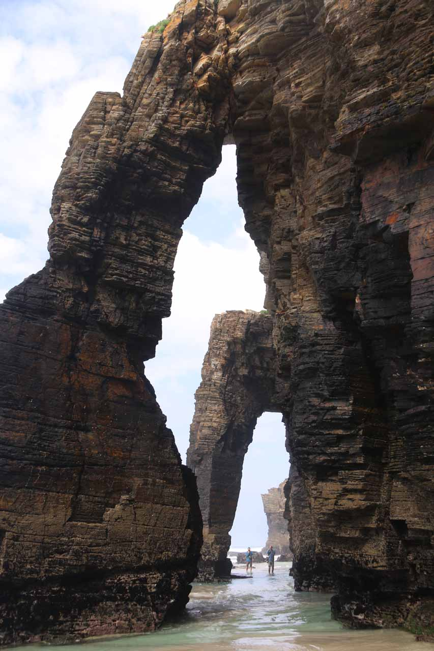 Looking up at two of the triple arches at Praia As Catedrais