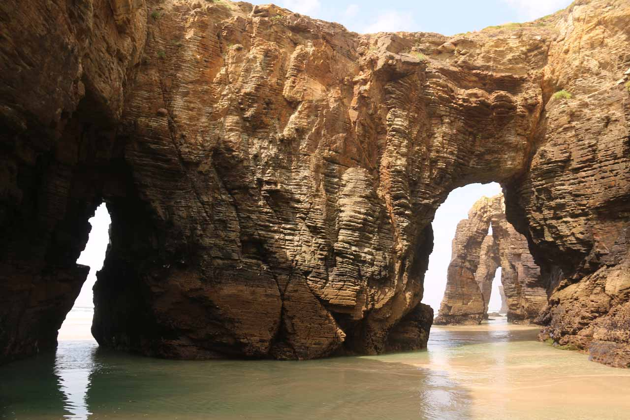 Context of the triple arches and the hidden arch at Praia As Catedrais all seen together