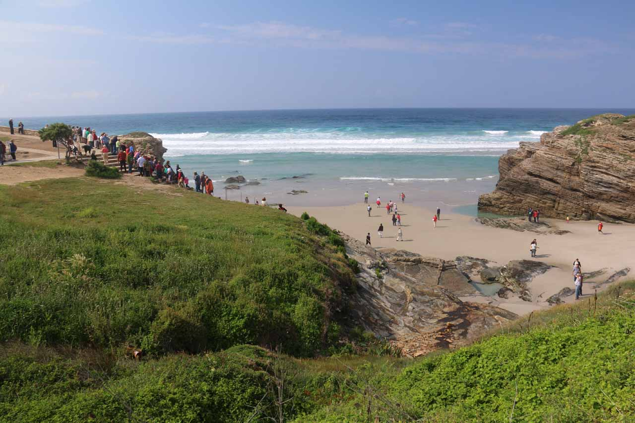 Context of lots of people going up and down the sea cliffs to the beach at Praia As Catedrais