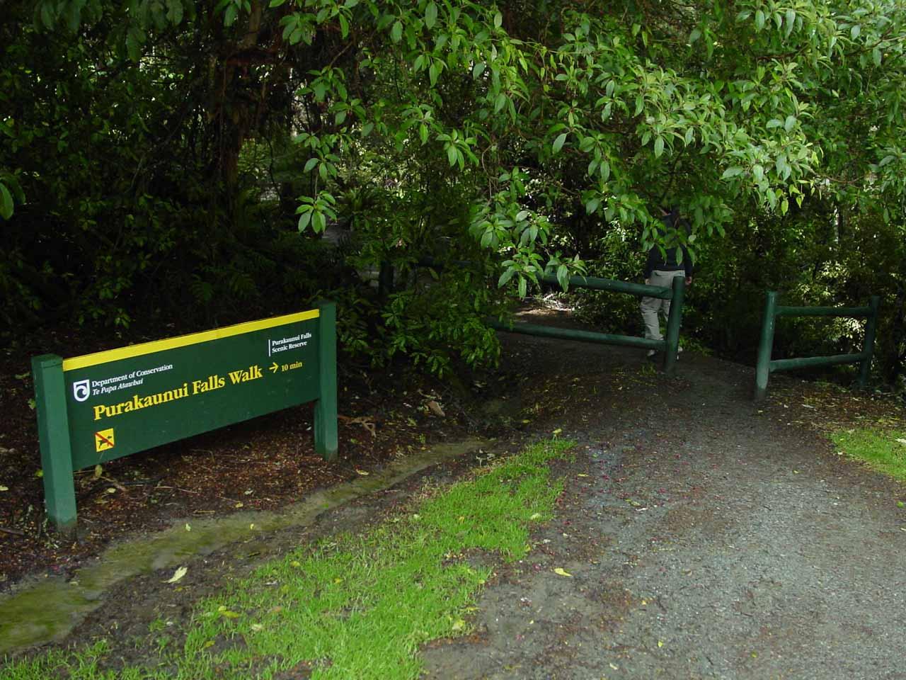 Julie going past the signposted trailhead for Purakaunui Falls
