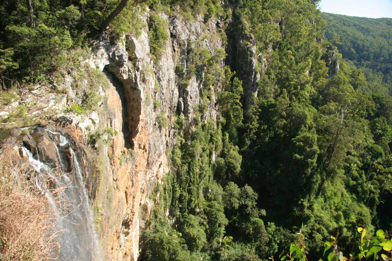 Context of Purling Brook Falls from its brink showing the vertical cliffs it plunged off of