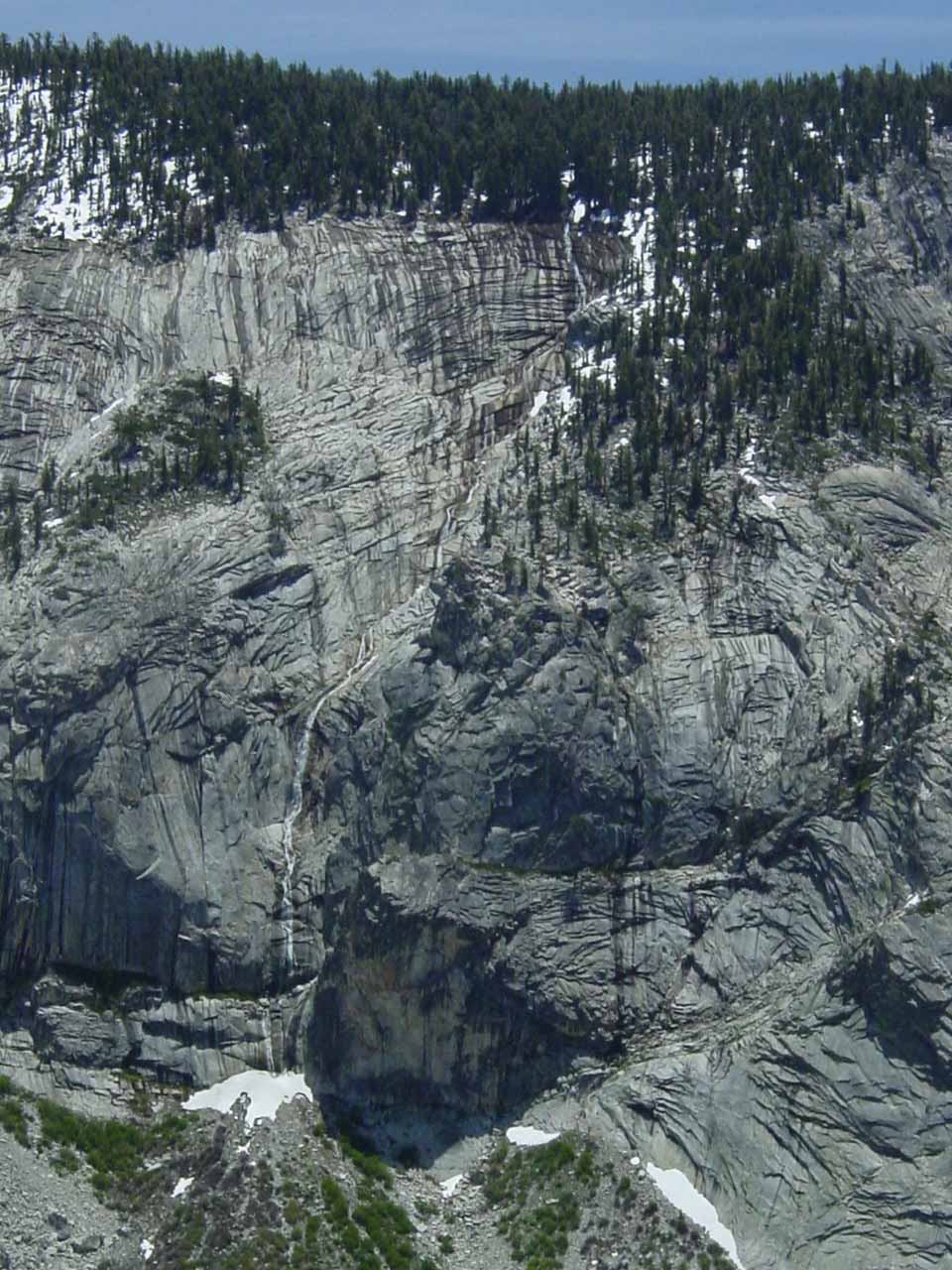 The thin, ephemeral waterfall spilling into the upper sections of Tenaya Canyon