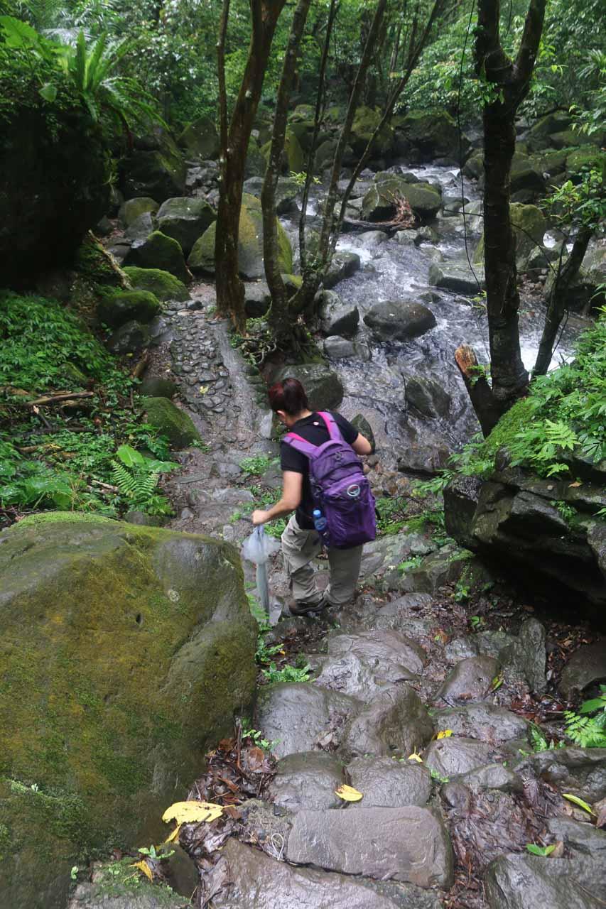 Mom carefully descending the wet and slippery rocks
