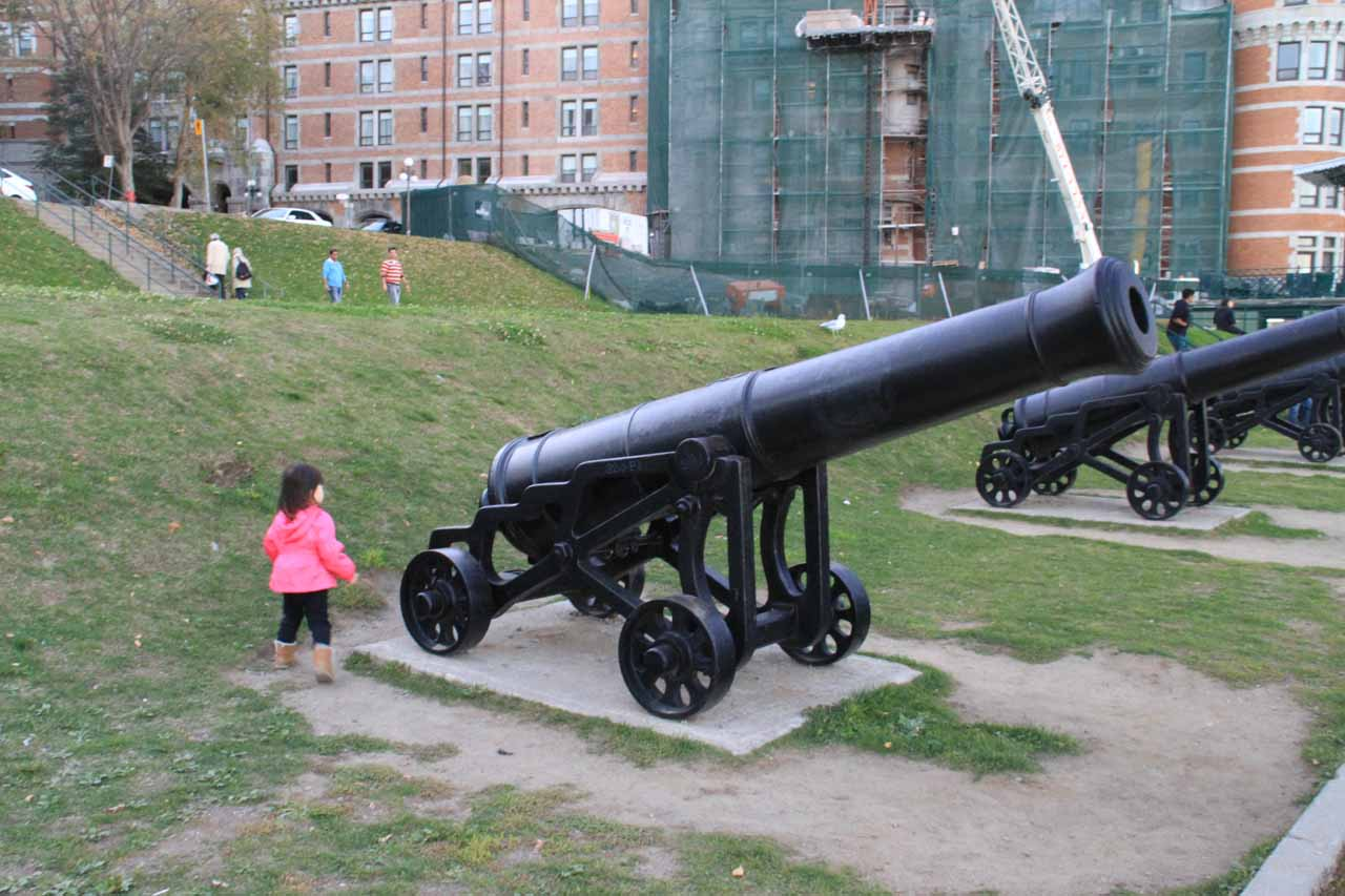 Tahia dwarfed by some cannons at the Governor's Walk